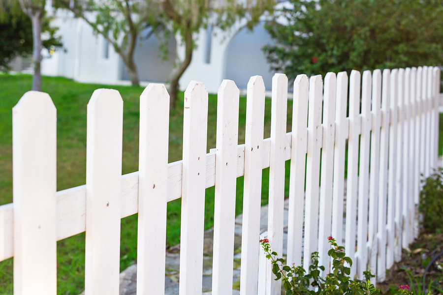 The New Orleans Fence Company Chain Iron Vinyl Wood